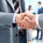 22400358 - handshake in front of business people