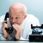 Businessman blurting by phone (focus on the man)
